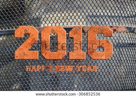 "The word ""2016"" written in rusty metal; - stock photo"