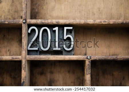 """The word """"2015"""" written in vintage metal letterpress type in a wooden drawer with dividers. - stock photo"""
