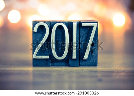 The word 2017 written in vintage metal letterpress type on a soft backlit background. - stock photo