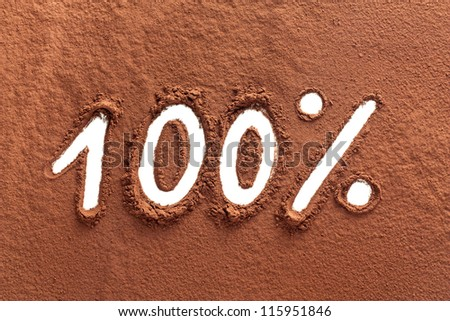 The word 100% written on cocoa powder - stock photo