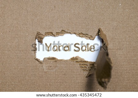 The word yard sale appearing behind torn paper. - stock photo