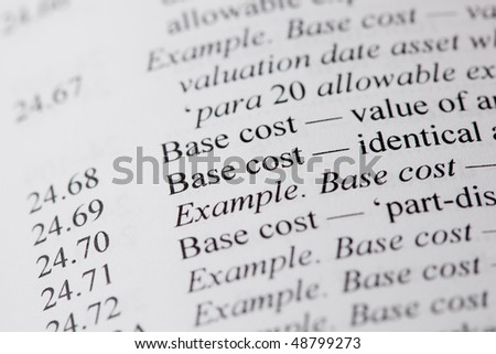 The words base cost typed on paper