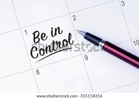 The words Be in Control on a calendar planner to remind you an important appointment with a pen on isolated white background. New Year concepts of goal and objective. - stock photo