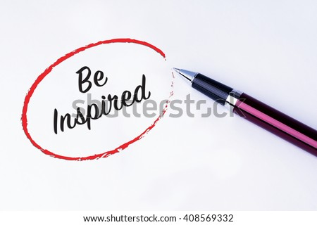 The words Be Inspired written in a red circle to remind you an important appointment with a pen on isolated white background. New Year concepts of goal and objective. - stock photo
