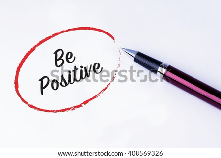 The words Be Positive written in a red circle to remind you an important appointment with a pen on isolated white background. New Year concepts of goal and objective. - stock photo