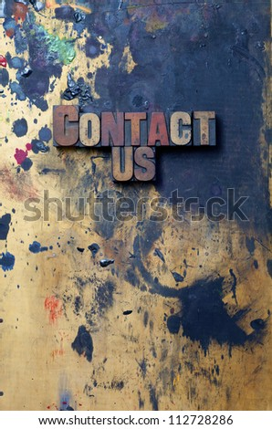 The words Contact Us written in antique letterpress printing blocks. - stock photo