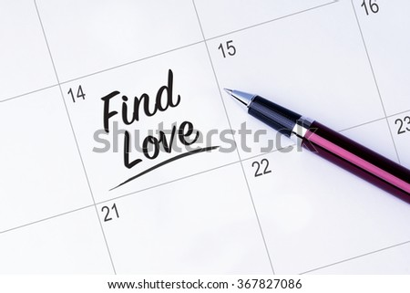The words Find Love written on a calendar planner to remind you an important appointment with a pen on isolated white background. Valentine's Day and Love Concepts - stock photo