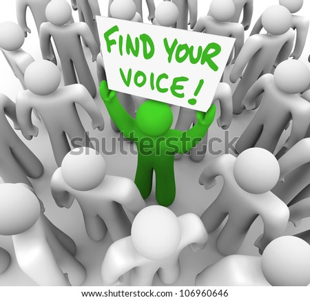 The words Find Your Voice on a banner held by a green man in a crowd of grey people, having just gained the confidence to speak what is on his mind and share his opinion and feedback - stock photo
