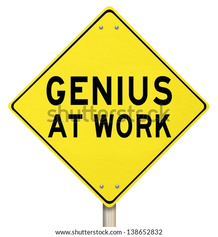 The words Genius at Work on a yellow road sign to give you warning that someone smart, brilliant, intelligent or extremely knowledgable is working on a project or goal - stock photo