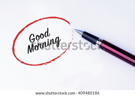 The words Good Morning written in a red circle with a pen on isolated white background. - stock photo