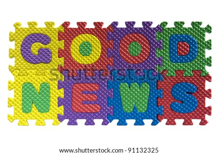 "The words ""Good news"" written with alphabet puzzle letters isolated on white background - stock photo"