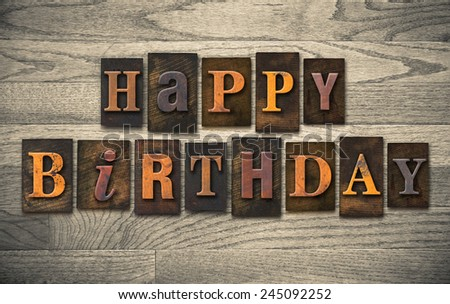 "The words ""HAPPY BIRTHDAY"" written in vintage wooden letterpress type. - stock photo"