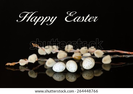 The words Happy Easter with bird eggs and pussy willows reflected on a black surface - stock photo