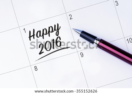 The words Happy 2016 on a calendar planner to remind you an important appointment with a pen on isolated white background. New Year concepts of goal and objective. - stock photo