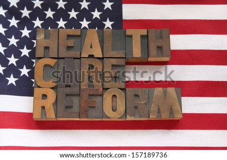the words health care reform on a USA flag - stock photo