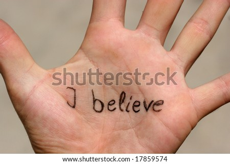 """The words """"I believe"""" written on a palm - stock photo"""