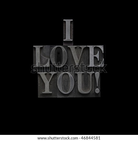 the words I love you in letterpress lead type - stock photo
