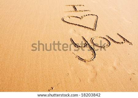 "The words ""I love you"" written in the beach sand - stock photo"