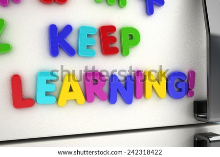 The words keep learning written on a refrigerator door with magnet letters - stock photo