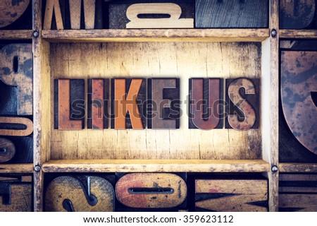 """The words """"Like Us"""" written in vintage wooden letterpress type. - stock photo"""