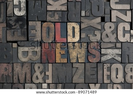 The words old news written in very old letterpress type - stock photo