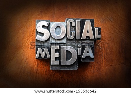 The words social media made from vintage lead letterpress type on a leather background. - stock photo
