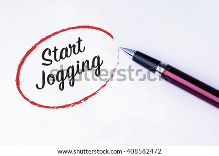 The words Start Jogging written in a red circle to remind you an important appointment with a pen on isolated white background. New Year concepts of goal and objective. - stock photo