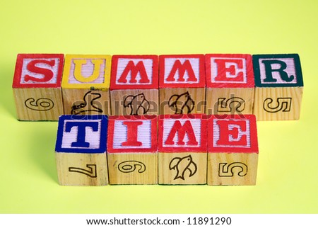 The words summer time spelled out using infants building blocks
