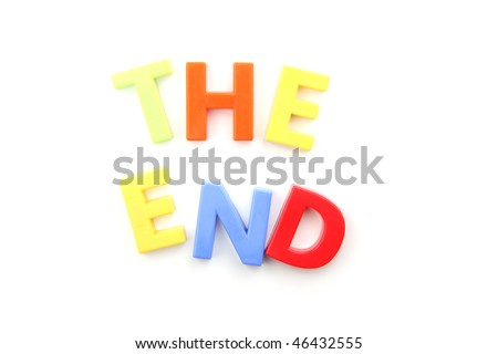 The words 'the end' spelled out using colored fridge magnets, isolated on white