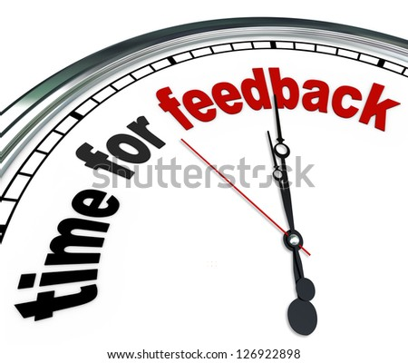 The words Time for Feedback on an ornate white clock, showing that it is time to collect input and responses in a question and answer session during a meeting or other group event