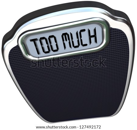 The words Too Much on the digital display of a scale symbolizing surplus, overabundance, overweight, fat and in need of a diet - stock photo