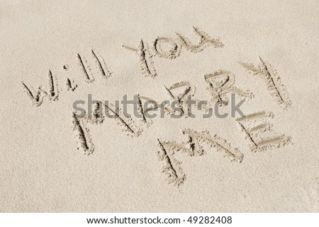"""The words """"Will You Marry Me"""" written in sand, horizontal with copy space - stock photo"""