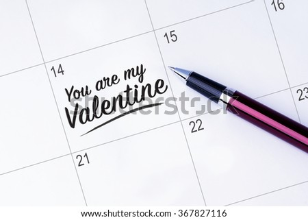 The words You are my Valentine written on a calendar planner to remind you an important appointment with a pen on isolated white background. Valentine's Day and Love Concepts - stock photo