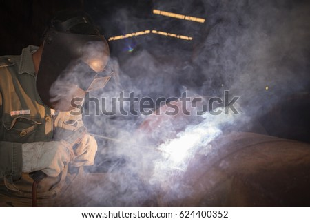 The worker are welding steel, Background of industry steel, Sparkles and light welding.