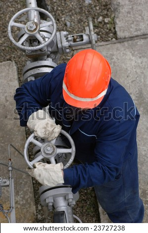 The worker of the gas refinery - stock photo