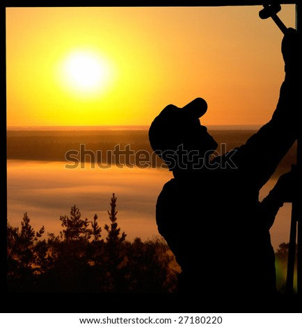 The worker on a background of the sun - stock photo
