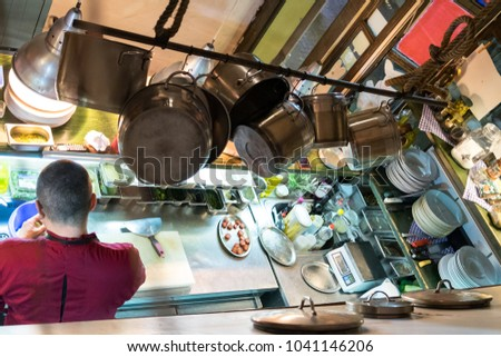 The working process of the chef cook on the kitchen of a modern seafood restaurant