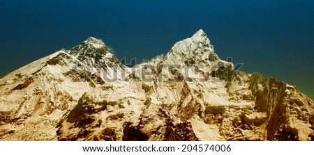 The world's highest mountain, Mt Everest (8850m) and Mt. Nuptse in the Himalayas, Nepal. - stock photo