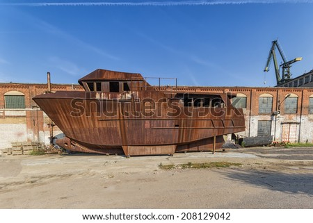 The wreck of the ship in the shipyard - stock photo