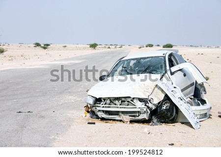 The wreckage of a car in the desert of central Qatar in 2003, apparently the result of a driver losing control at high speed - stock photo