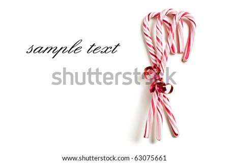 the xmas concept with stripy candy cane - stock photo