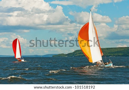 The yacht is participating in a regatta in gloomy weather - stock photo