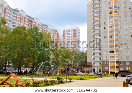 The yard between the buildings - stock photo