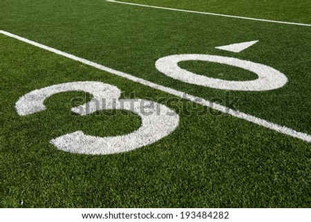 The 30 yard line on an American Football field. - stock photo