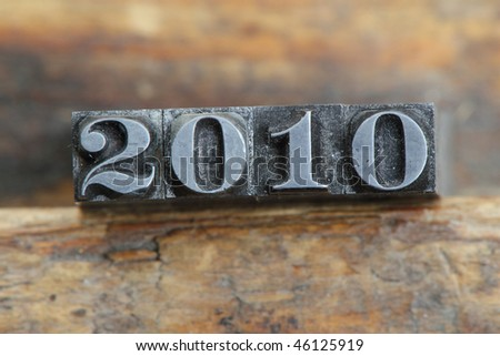 the year letterpress type on a wooden background. - stock photo