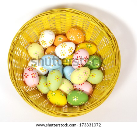 The yellow Easter basket with painted eggs  - stock photo