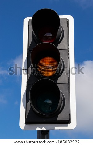 The yellow street light. - stock photo