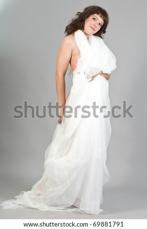 The young attractive girl in a white cape - stock photo