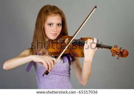 The young attractive girl with a violin - stock photo