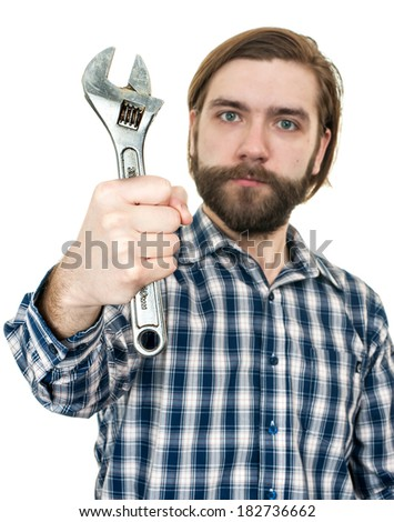 the young bearded man a holding wrench in hand - stock photo